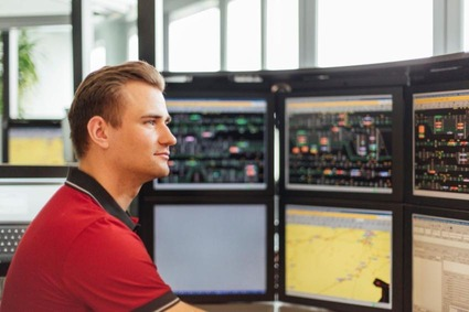 Train dispatcher in front of screens