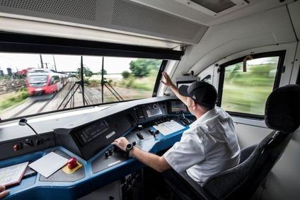 Train driver steering a train