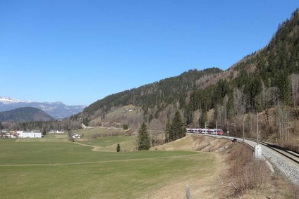 Landscape image with train on the Pyhrn Line