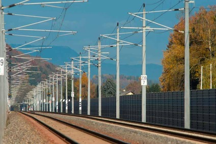 Railway track with overhead contact line