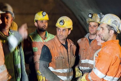 Miners inside the tunnel.