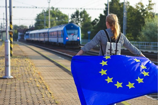 Woman with EU flag on a platform in Europe
