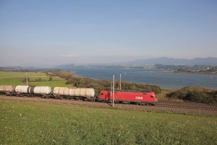 Freight train passing a lake