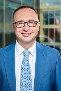 Portrait of the management board member Johann Pluy