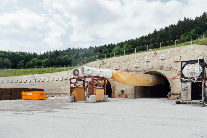 The photo shows the entrance of two tunnel tubes.