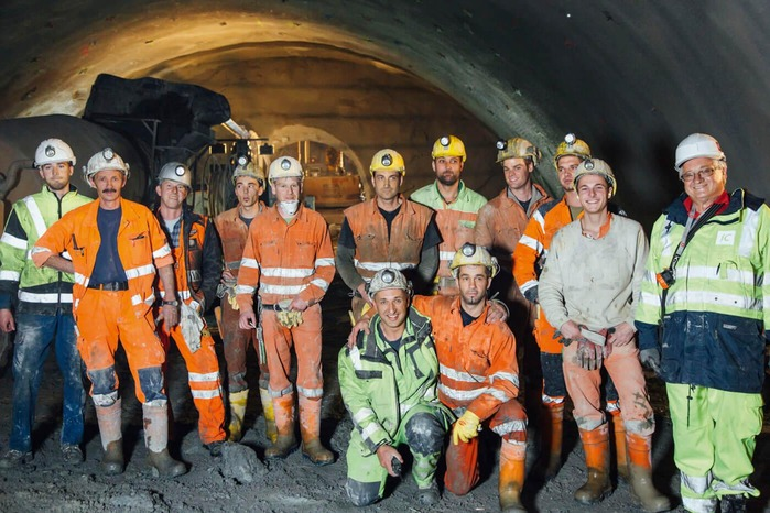 A group of miners posing for a photo.