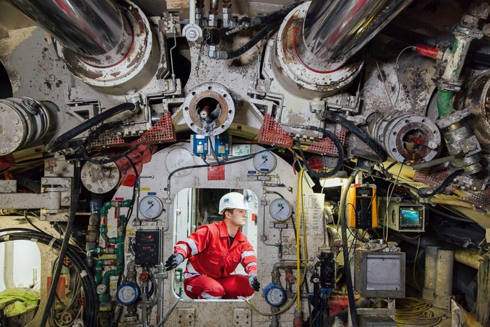 A mechanic checks the different values of a tunnel drilling machine.