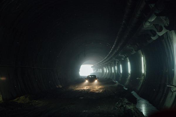 A car drives through a tunnel.