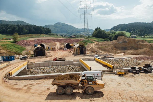 This picture shows a construction site and two exposed tunnel tubes.