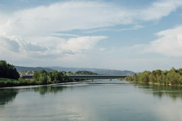 A bridge runs across a river.