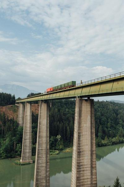 A freight train crosses a railway bridge.