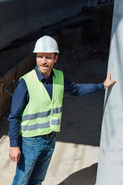 A construction worker inspects the construction progress.