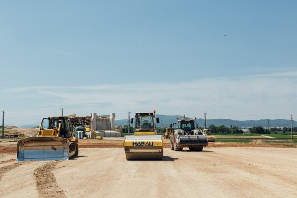 several excavators at the construction site