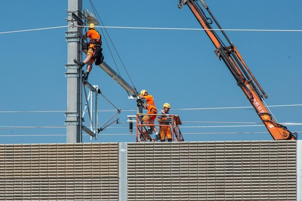 construction workers working on a power pole