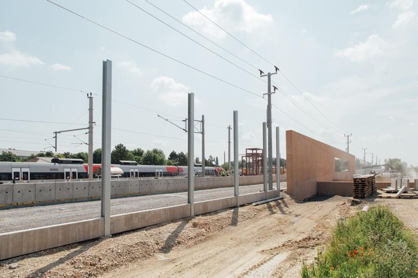 construction site with passenger train
