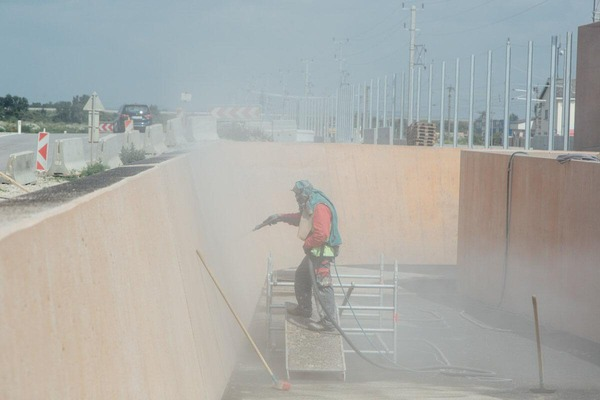 Construction worker works in the underpass
