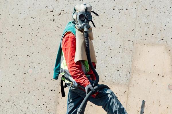 Construction worker wears work mask