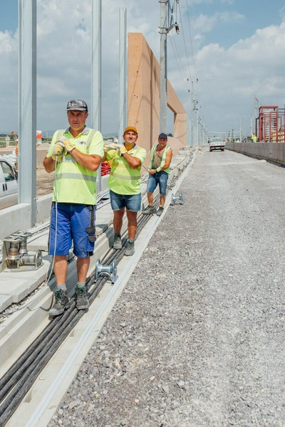 several construction workers work together on the new rail network