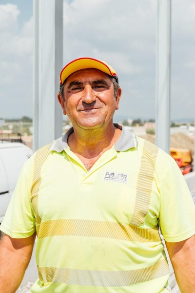 Construction worker with high visibility vest and cap