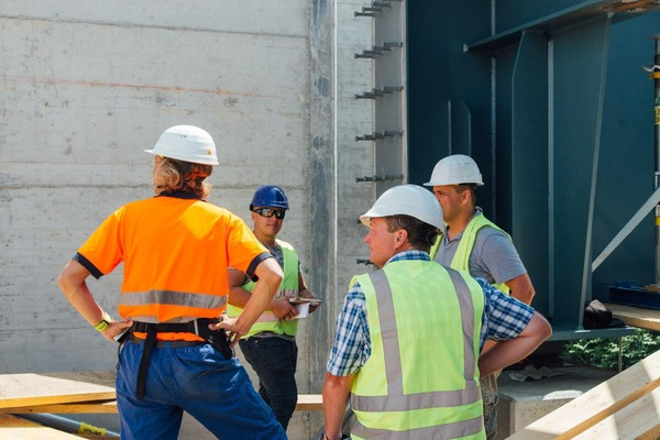 Construction workers talk about the construction site