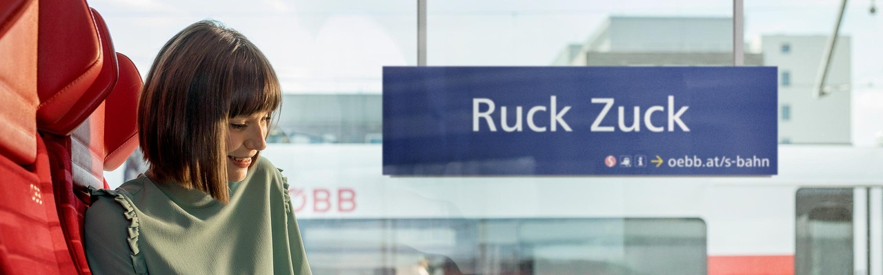 """S-Bahn subject """"Ruck Zuck"""" - woman sitting in front of the train window"""