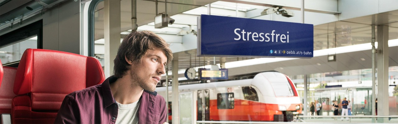 "S-Bahn subject ""Stress-free"" - man looks lost in thought out of the train window"