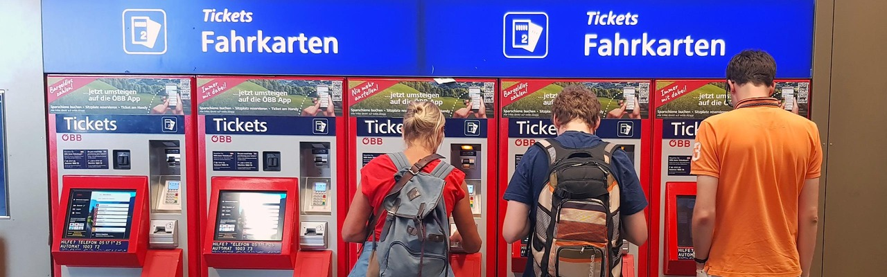 People stand in front of ticket machines