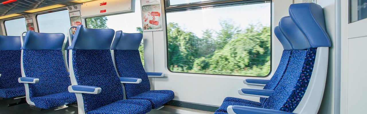 Local train interior view with seating area