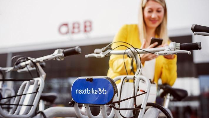 Woman photographs e-bike in the bike rack