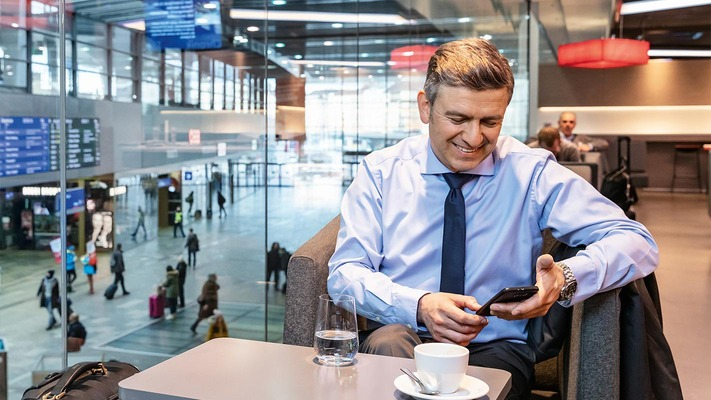 Business travelers in the Vienna Central Station lounge
