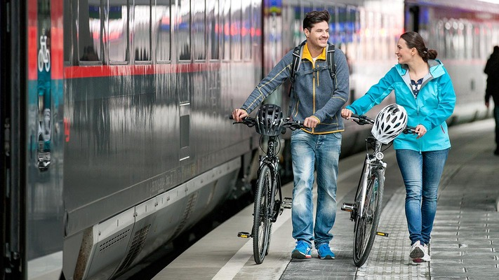 Couple on the platform with bicycles