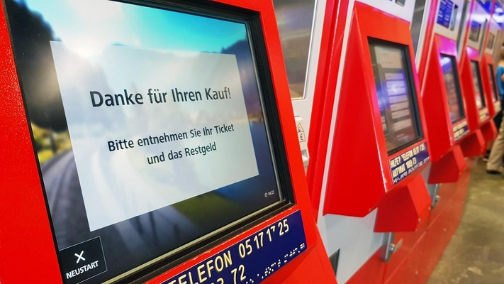 "Ticket machine with ""Thank you for your purchase"" screen"